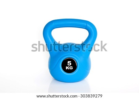 5 kg blue kettlebell isolated on white background. Weights for a fitness training. - stock photo