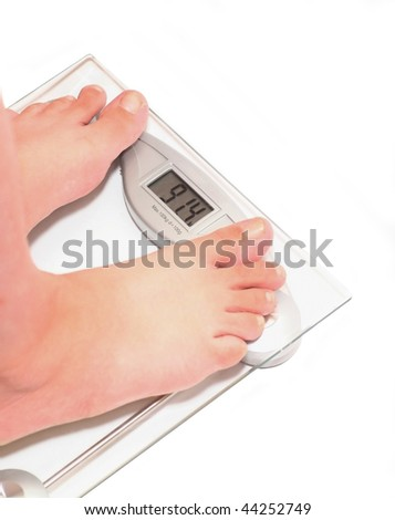 91,4 kg - time to lose weight. Woman's feet on scale. Clipping path included. White background