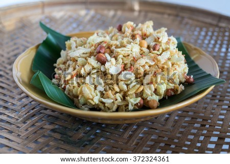 """""""Khao Mao Mee"""" or Khao Tang Sa-Wouy, Thai Crispy fried pounded unripe rice snack. Traditional dessert or snack of Thailand. Today, it is rare to find. - stock photo"""