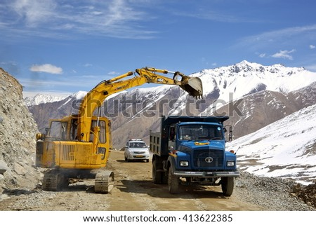 KHARDUNG LA PASS, INDIA â?? APRIL 21, 2016: Road construction at Kardung La one of th highest motorable road (5360 m) in the world. The pass is strategically important to India.  - stock photo