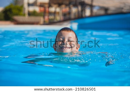 kid swimming and playing in water. summertime - stock photo