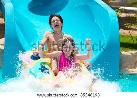 Kids on water slide - stock photo
