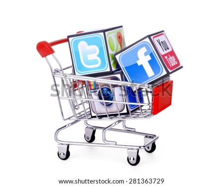 KIEV, UKRAINE - MAY 25, 2015: Cubes with logotypes of social media: Facebook, Twitter, instagram, placed into shopping cart . - stock photo