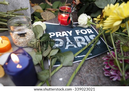 KIEV,UKRAINE - November 14, 2015: People lay flowers at the French Embassy in Kiev in memory of the victims of the November 13 terror attacks in Paris.  - stock photo