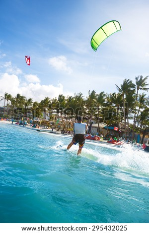 Kitesurfing in ocean at Bali  - stock photo