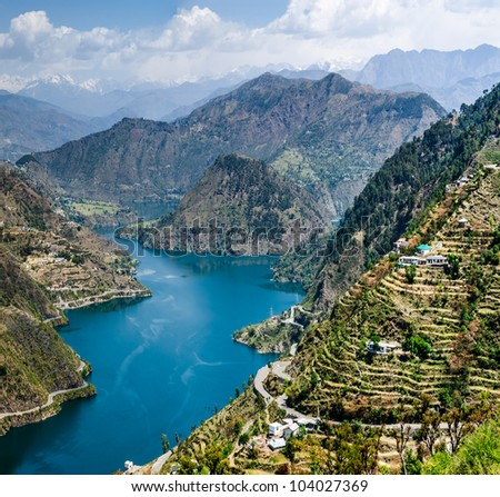 46 kms long tehri lake filling up after the construction of the New Tehri hydro electric project Dam on the river ganga in tehri garhwal chamba - stock photo