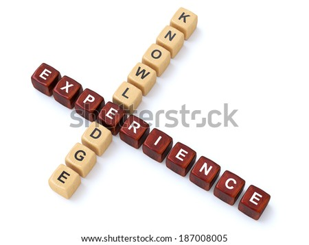 Knowledge and Experience wooden crosswords - stock photo