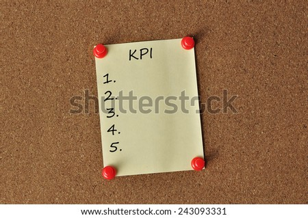 """""""KPI"""" on Yellow Note Paper With Red Push Pins On Board Backgroud - stock photo"""