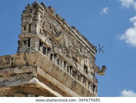 """La Iglesia,"" a Mayan government building with elaborate bas relief on the facade, in Chichen Itza - stock photo"