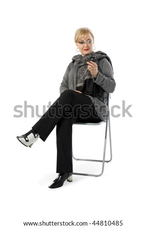 Lady dialing text message on white background - stock photo