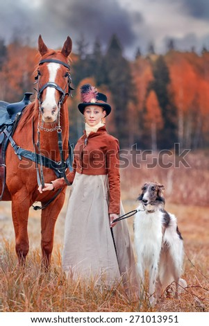 Lady in riding habbit XIX Century with russian borzoy dogs at horse hunting.