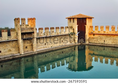 Lagoon inside the Scaliger Castle - medieval port fortress, Sirmione, Italy - stock photo