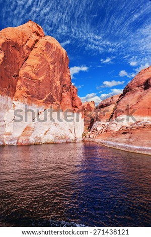 Lake Powell is surrounded by magnificent red hills. Walk on the boat at sunset. Scenic huge artificial water basin of the Colorado River, USA - stock photo
