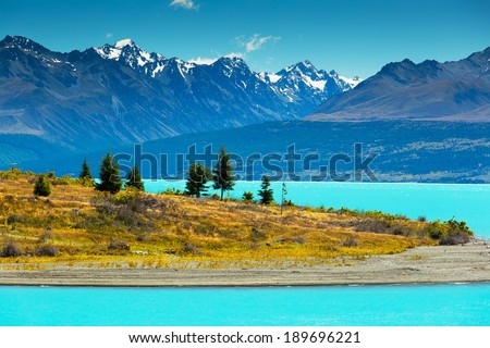 Lake Pukaki view from Glentanner Park Centre near Mount Cook, on a background of blue sky with clouds, snowy Southern Alps.  - stock photo