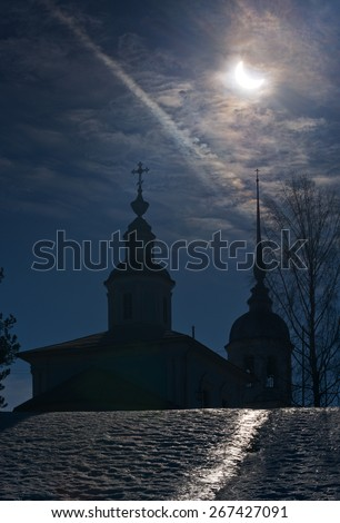 Landscape with a solar Eclipse that occurred this spring. - stock photo