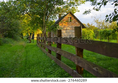 landscape with country house and green forests  - stock photo