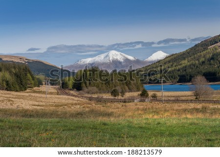 Landscape with Snowy Mountain, Forest and Lake in Spring - stock photo