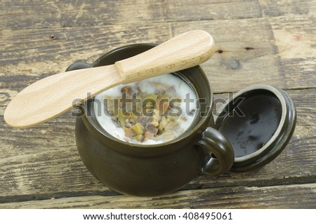 lard with spices in clay pot  - stock photo