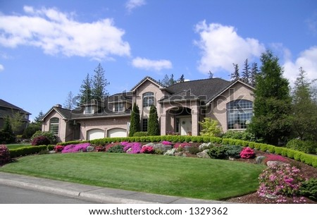 Large Brick Home with immaculate landscaping - stock photo