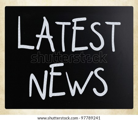 """Latest news"" handwritten with white chalk on a blackboard - stock photo"