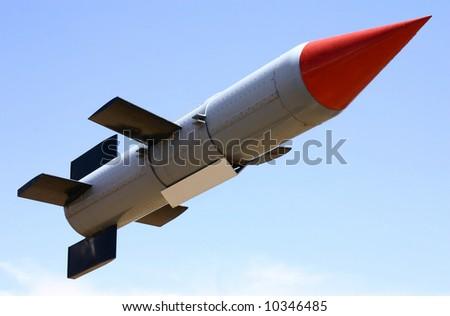 - 'launched' rocket - symbol for success, achievement etc - stock photo