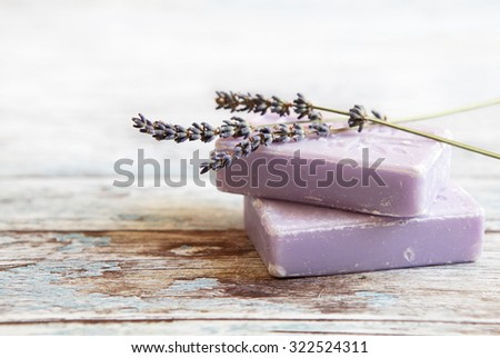 lavender soap  on rustic wooden board - stock photo