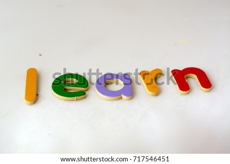 'learn' spelled out in wooden letters (concept)