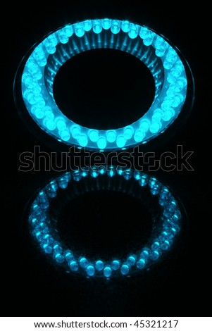 48 LEDs arranged in the ring and are reflected on a polished granite slab. - stock photo