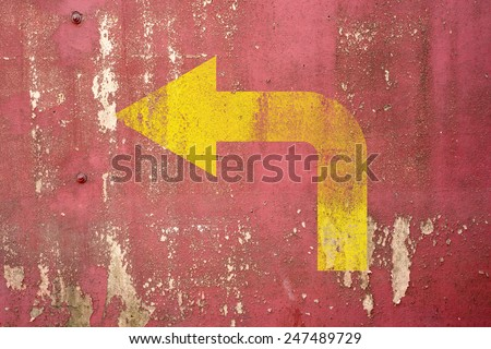 left turn road sign painted on wall,vintage wall background - stock photo