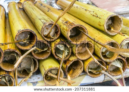 """Lemang"" already cooked in a hollowed bamboo stick - stock photo"