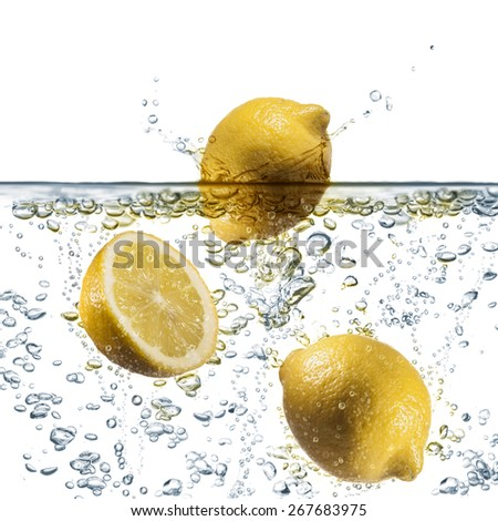 lemon splash on sparkling water, on white background - stock photo