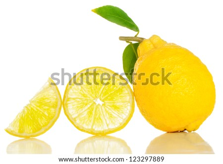Lemon  whole and slices with green leaves. Isolated on white - stock photo