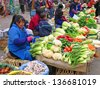 LHASA, TIBET-NOVEMBER 12: lady selling vegetables in Barkhor Street. The ancient street is a symbol of Lhasa and a must see place for visitors. November 12, 2004 in Lhasa, Tibet - stock photo