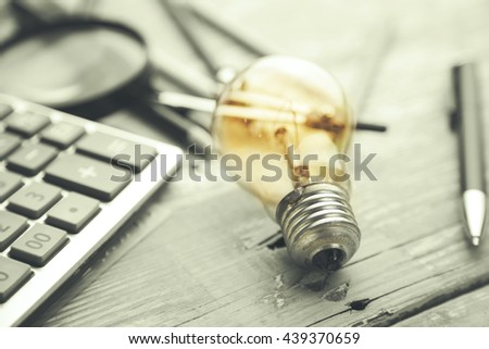 light bulb,calculator ,stationery, creative writing concept