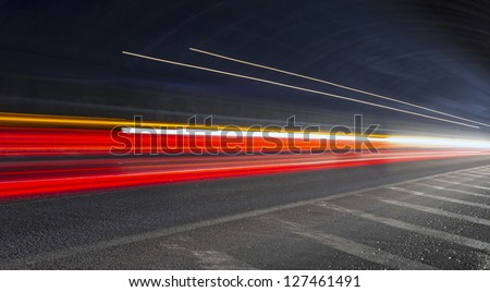 light trails in tunnel. Art image . Long exposure photo taken in a tunnel - stock photo