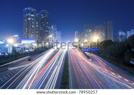 light trails on the busy street - stock photo