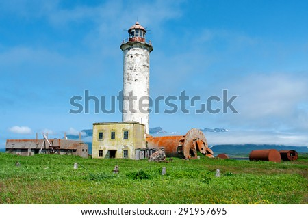 lighthouse off coast of island Paramushir, Russia - stock photo