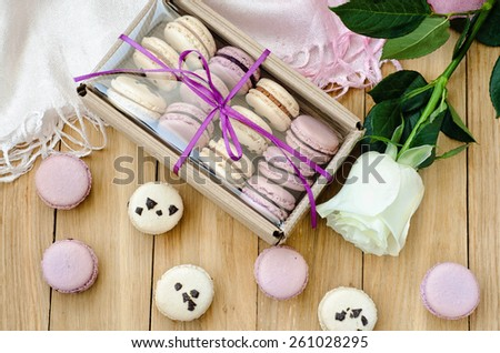 Lilac macaroons with rose and gift box for valentine's day or mother's day - stock photo