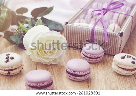 Lilac macaroons with rose and gift box for valentine's day or mother's day. Selective focus - stock photo