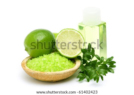 lime bath salt, oil bath and some fresh fruit - stock photo