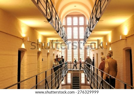Lincoln, UK - April 9, 2015: Tourists visit medieval prison inside Lincoln Castle, a major castle constructed in Lincoln, East Midlands, England during the late 11th century by William the Conqueror.