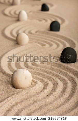 line black and white  stones, standing on the sand, can be used as background
