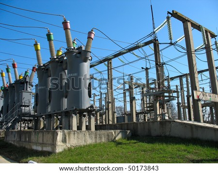Line of high voltage electric converters equipment at a power plant - stock photo
