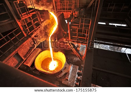 Liquid iron inside of plant and trains - stock photo