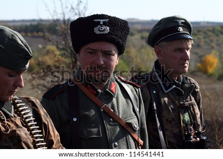 LISICHANSK -SEPT 30 : ordinary SS and Cossack, who fought on side of Wehrmacht, Zaporozhye and Lugansk history clubs wears historical German uniform, Sept 30, 2012, Lisichansk, Lugansk, Ukraine