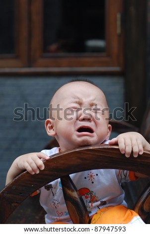 little Asian  boy  outdoor - stock photo