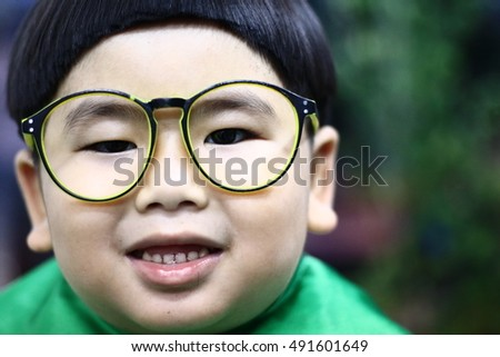 Little baby with Glasses, new family and love concept. Asian cute boy trying to sit still for a barber THAILAND, Cute child scared and doesn't like to cut my hair