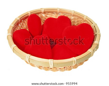 Little basket with plush hearts in it over white background - stock photo