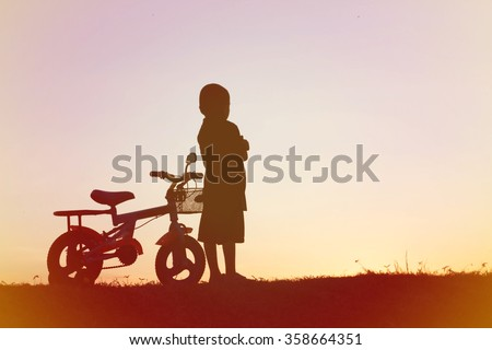 little boy bike silhouette
