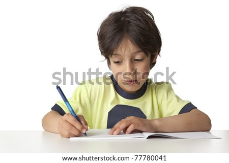 Little boy is writing in his notebook on white background - stock photo
